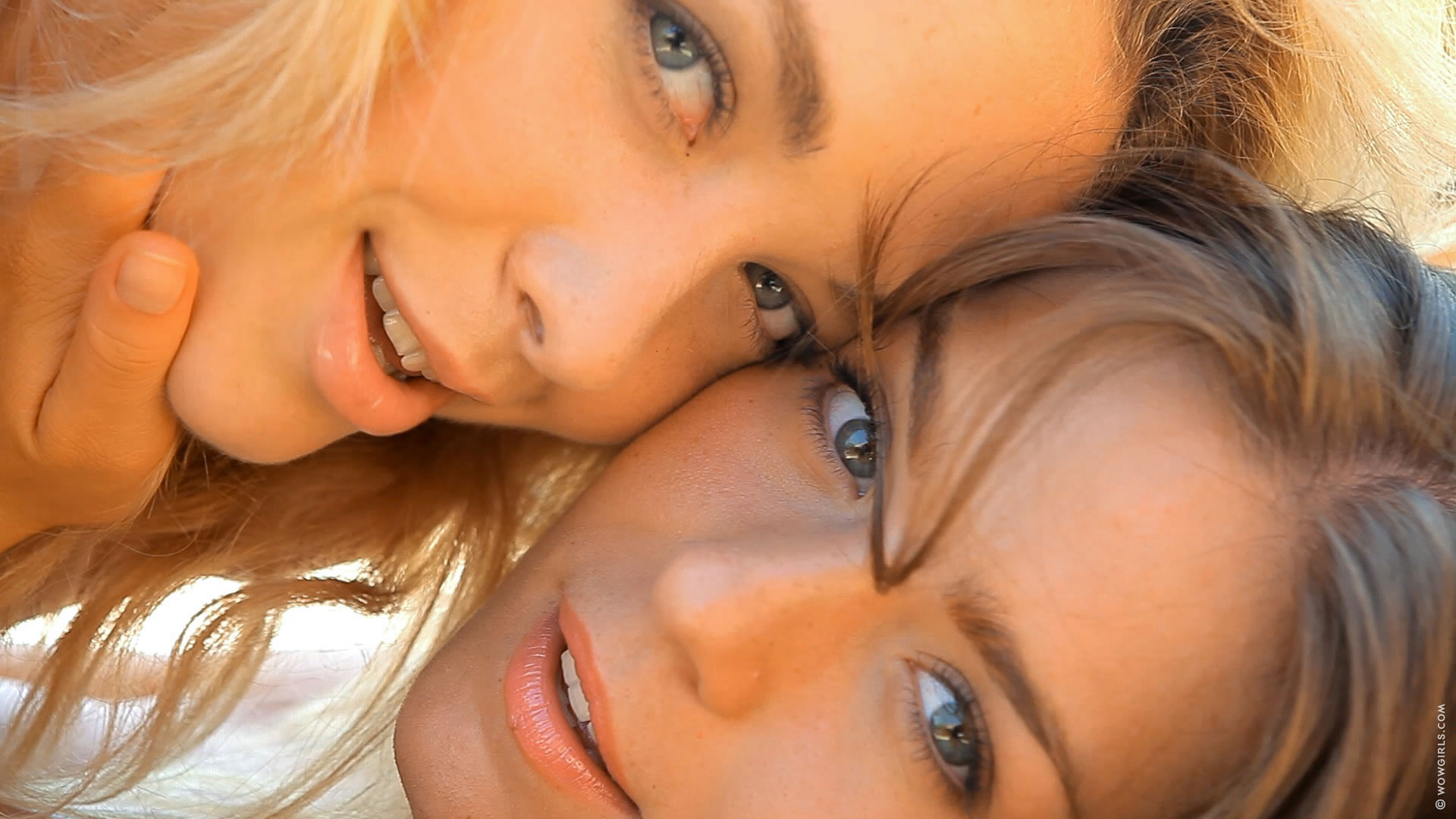 Two fresh lesbian teen babes give rimjob to each other